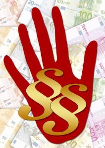 Foto Hand mit Geld und Paragraphen